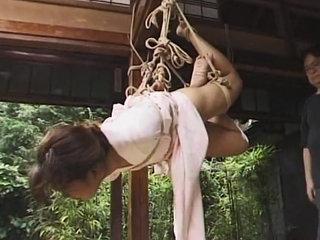 Outdoors bondage scene of Japanese girl tied